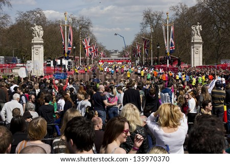 LONDON, UK - APRIL 21: The Finish Line of London Marathon just opposite Buckingham Palace with runners approaching the end of the marathon on April 21, 2013 in London, UK. - stock photo