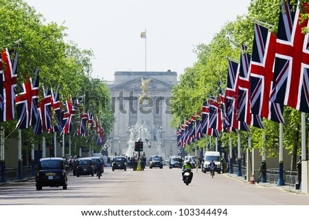 LONDON, UK - APRIL 28, 2011: The Mall is decorated with Union Jack flags in preparation of the Royal Wedding to be held the day after on April 28, 2011 in London. - stock photo