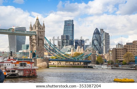 LONDON, UK - APRIL 30, 2015: Tower bridge and City of London financial aria on the background. View includes Gherkin and other buildings - stock photo