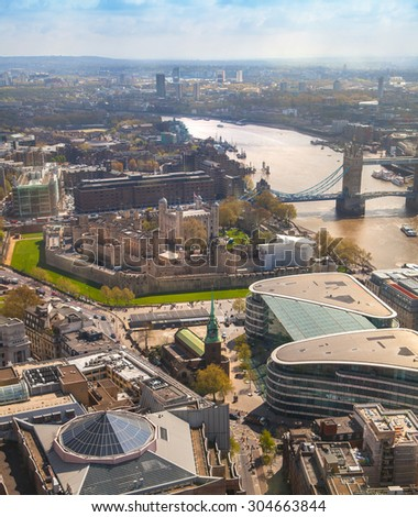 LONDON, UK - APRIL 22, 2015:  Tower bridge, Tower of London and river Thames. Panoramic view from the 32 floor of London's skyscraper