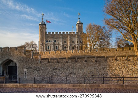 LONDON, UK - APRIL15, 2015: Tower of London (started 1078), fortress and house of Royal Crown Jewels. View form the river side park