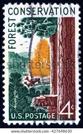 London, UK, April 5 2008 - Vintage 1958 United States of America cancelled postage stamp showing an image of forest conservation - stock photo