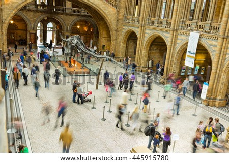 LONDON, UK - APRIL 28 2013: Visitors in the main entrance hall at London's  Natural History Museum. One of the Capitals most popular tourist attractions in April, 2013. - stock photo