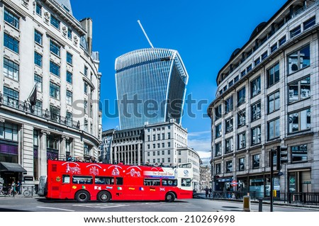 LONDON, UK - AUG 11: a London sightseeing double-decker bus on King William St in the City of London on August 11, 2014. - stock photo