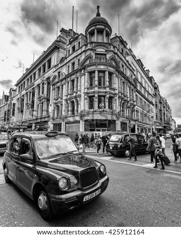 LONDON, UK - AUG 24, 2014: A London Taxi or 'Black Cab' in Piccadilly Circus in black and white. - stock photo