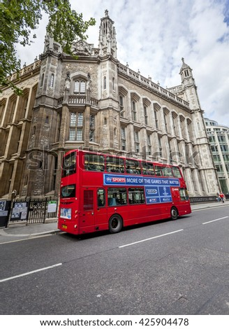 LONDON, UK - AUG 24, 2014: Famous London red bus picking up commuters in the streets of London during the daytime. - stock photo