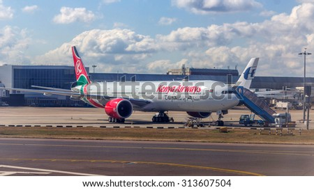LONDON, UK - AUG 25, 2015: Kenyan Airways airplane arriving at London Heathrow Airport. Heathrow is the busiest airport in the United Kingdom and the busiest airport in Europe by passenger traffic. - stock photo