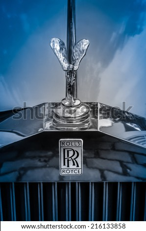 LONDON, UK - AUG 30, 2014: Spirit of Ecstasy hood ornament on English Luxury Rolls-Royce Silver Shadow Car On A Cobblestone Street In London, UK, Aug 30, 2014 - stock photo