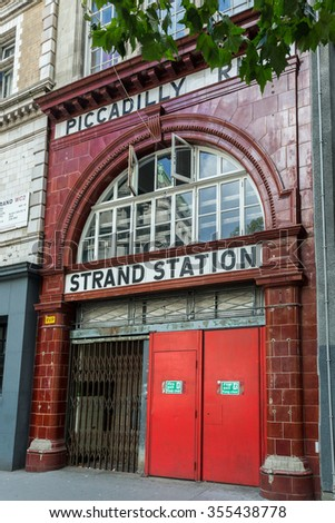 London, UK, 31 August 2014. Entrance to the disused Strand/Aldwych London Underground Station. On the Piccadilly Line the station opened in 1907 and closed in 1994. It is a Grade II Listed Building. - stock photo