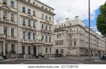 LONDON, UK - AUGUST 24, 2014: Exhibition road. Expensive privater properties of Kensington in front of National history museum.  - stock photo