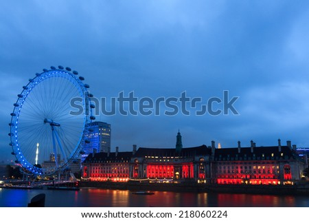 LONDON, UK- AUGUST 8, 2014: London Eye in London, United Kingdom is the tallest Ferris wheel in Europe at 135 meters.  - stock photo