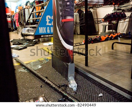 LONDON, UK - AUGUST 9: London Riots.: View looking inside a branch of JD Sports, Mare street Hackney, wrecked by looters in the riots. August 9, 2011 in London UK. - stock photo