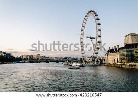 LONDON, UK - AUGUST 23, 2015: London skyline in the evening. The London Eye on River Thames