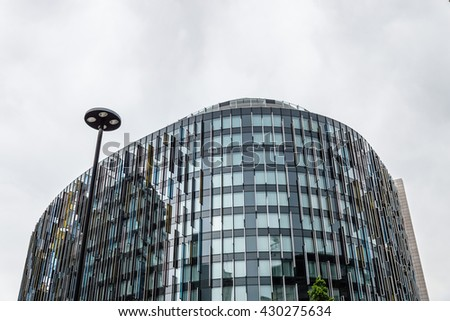 LONDON, UK - AUGUST 18, 2015:  Low angle view of modern office building and hotel in London a cloudy day. London is the second most important financial center in the world according to Forbes