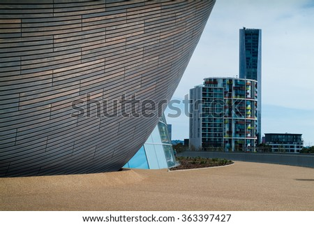 London, UK - August 2nd, 2015: closeup photo of the London Aquatics Center, with Stratford tower blocks in the background.