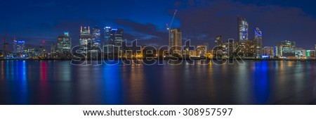 LONDON, UK -AUGUST 22, 2015: Night view of Canary Wharf, a major business district located in London, UK. It's a home to the headquarters of numerous major banks and other professional service firms