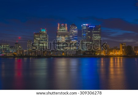 LONDON, UK - AUGUST 22, 2015: Night view of Canary Wharf, a major business district located in London, UK. It's a home to the headquarters of numerous major banks and other professional service firms