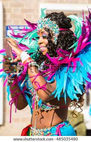 London, UK - August 29, 2016: Notting Hill Carnival is the largest street party in Europe and takes place at the Royal Borough of Kensington and Chelsea each August over the two days of bank holiday.