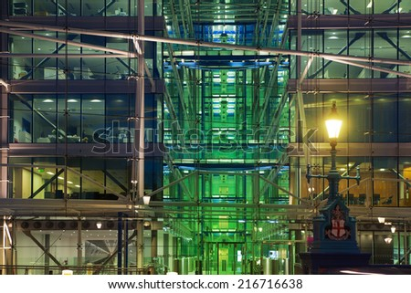 LONDON, UK - AUGUST 11, 2014: Office building in the night lights - stock photo