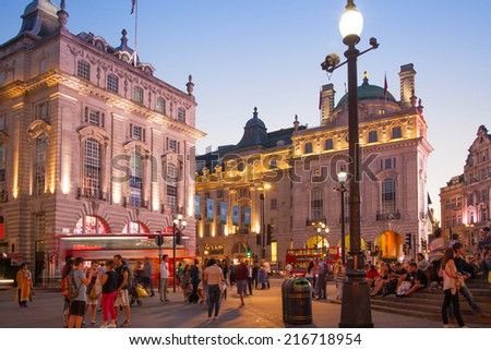 LONDON, UK - AUGUST 22, 2014: Piccadilly Circus in night. Famous place for romantic dates. Square was built in 1819 to join of Regent Street  - stock photo
