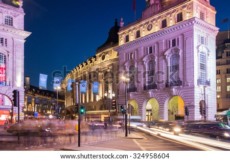 LONDON, UK - AUGUST 22, 2015: Piccadilly Circus in night. Famous place for romantic dates. Square was built in 1819 to join of Regent Street - stock photo