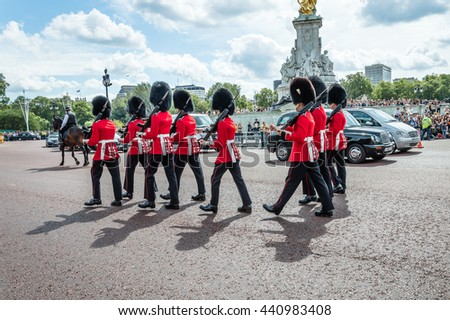 London, UK - August 19, 2015: Royal Guards parade during traditional Changing of the Guards ceremony near Buckingham Palace. This ceremony is one of the most popular tourist attractions in London. - stock photo