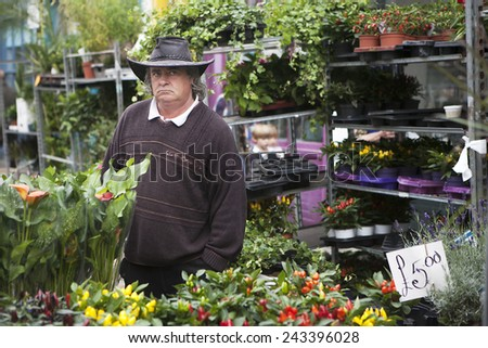 LONDON, UK - AUGUST 30: Seller sell flowers at the Colambia flower market on August 30, 2014 in London, UK. - stock photo