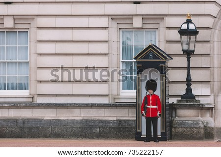 LONDON, UK - AUGUST 10: the guard stand in the front of Buckingham Palace at August 10, 2017 in London, UK