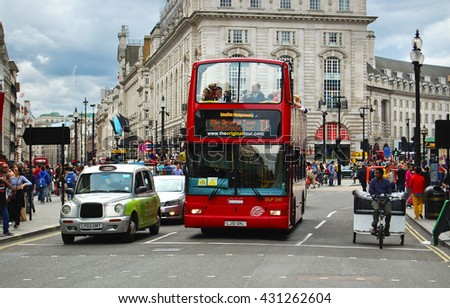 LONDON, UK - August 30, 2014: Tourist Red double decker buses are a traditional landmark of London  - stock photo