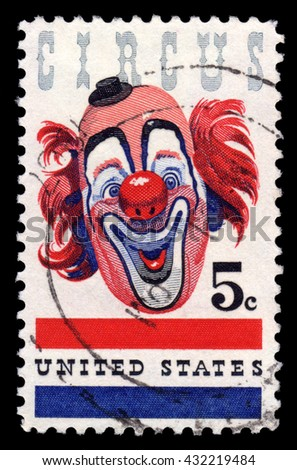 London, UK, August 14 2010 - Vintage 1966 United States of America cancelled postage stamp showing the face of a circus clown with a red nose