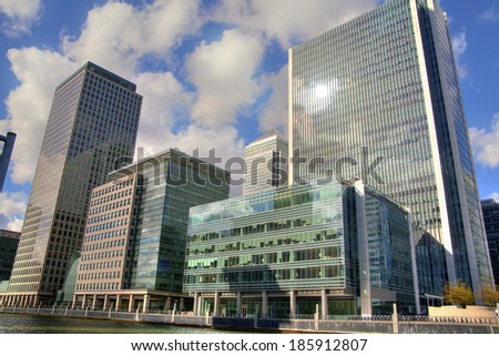 LONDON, UK - CANARY WHARF, MARCH 22, 2014: Modern glass buildings of biggest business district in London. HDR proceeding image