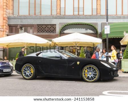 LONDON, UK - CIRCA AUGUST 2013: A Ferrari 599 GTB Fiorano with a black velvet wrap. - stock photo
