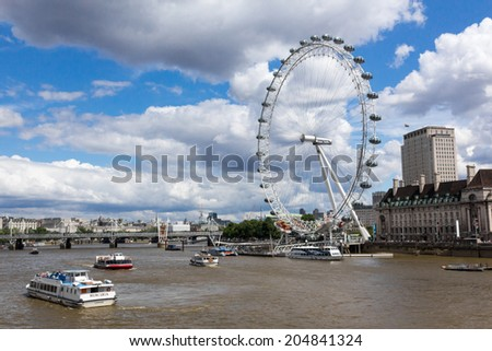 LONDON, UK / CIRCA JULY 2014 - The famous London Eye and the Thames river, two of London's most iconic landmarks seen on a bright summer day