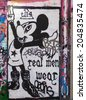 LONDON, UK / CIRCA JUNE 2014 - Graffiti with Mickey Mouse made by unknown artist seen on Leake Street public gallery - stock photo