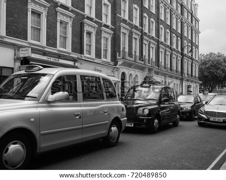 LONDON, UK - CIRCA JUNE 2017: Taxi cabs in the city centre in black and white