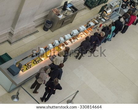 LONDON, UK - CIRCA MARCH, 2009: People queueing at the British Museum cafeteria bar in the Great Court - stock photo