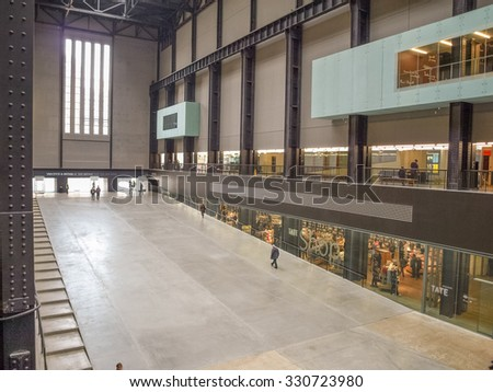 LONDON, UK - CIRCA MARCH, 2009: Tourists visiting the Turbine Hall which once housed the electricity generators of the power station now part of Tate Modern art gallery in South Bank - stock photo