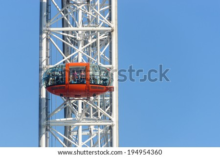 LONDON, UK - CIRCA OCTOBER 2012: People enjoying the view over London from a capsule of the EDF Energy London Eye.