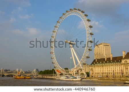 LONDON, UK - CIRCA SEPTEMBER 2013: The London Eye and the Sea Life London Aquarium on the south bank of the river Thames. - stock photo