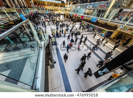 LONDON, UK - CIRCA SEPTEMBER 2015: Travellers at Liverpool Street Station - wide angle view (HDR)