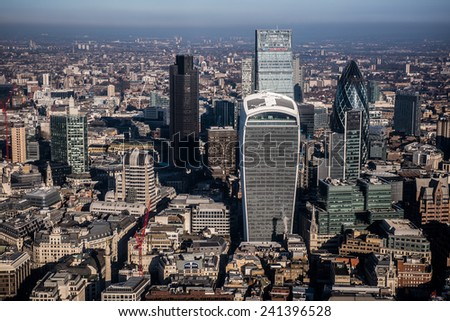 LONDON, UK - DEC 29: Aerial view of the City with Tower 42, 20 Fenchurch Street (The Pint), 122 Leadenhall St (The Cheesegrater) and 30 St Mary Axe (The Gerkin) in London on December 29, 2014. - stock photo