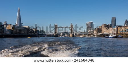 LONDON, UK - DEC 29: New skyline with The Shard, Tower Bridge, 20 Fenchurch Street (aka The Pint) and 122 Leadenhall St seen from a ferry flowing on the river Thames in London on December 29, 2014 - stock photo