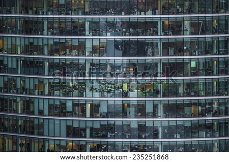 LONDON, UK - DEC 2: people work in an office building in London on December 2, 2014. Fulltime employees in the UK work longer hours than the EU average according to the Office for National Statistics  - stock photo