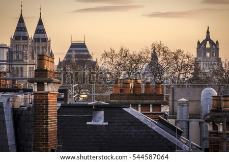London, UK - Dec 10 2012 : The late afternoon view of rooftops and steeples in the London borough of South Kensington.  London is one of the most popular visitor attractions in Europe.  .