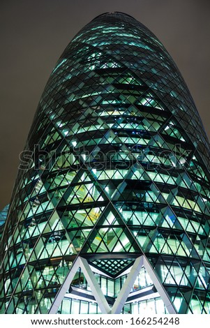 LONDON, UK - DECEMBER 6, 2013: A closeup to The Gerkin/St Marys Axe which is located in the City of London during the night on December 6 2013 - stock photo