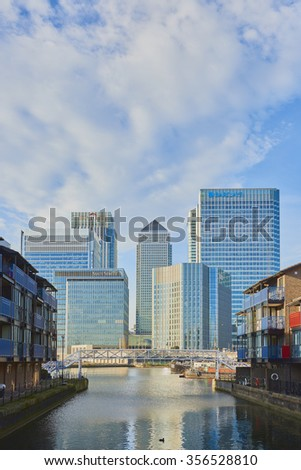 LONDON, UK - DECEMBER 28: Canary Wharf's banks' skyscrapers on sunny blue sky day seen from Blackwall. December 28, 2015 in London. - stock photo