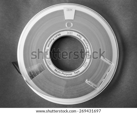 LONDON, UK - DECEMBER 31, 2014: IBM reel tape for computer data storage in black and white