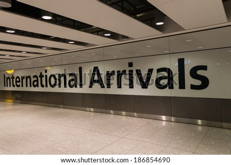 LONDON, UK - DECEMBER 30, 2012 : Inside Heathrow Airport Terminal 5 Arrivals on December 30, 2012 in London, England. London Heathrow Airport is the largest airport in the United Kingdom. - stock photo