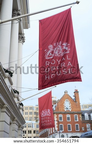 LONDON, UK - DECEMBER 20: Large red banners in front of the Royal Opera House, depicting the Royal coat of arms. December 20, 2015 in London. - stock photo