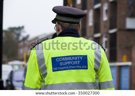 LONDON, UK - DECEMBER 11, 2015  Police officer in Bracknell Close where a man was shot and killed during a police operation. which was reportedly sought to disrupt an ongoing plot to free a prisoner - stock photo